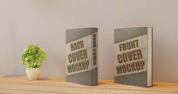 Makieta książki na przedniej i tylnej okładce na biurku na ścianie