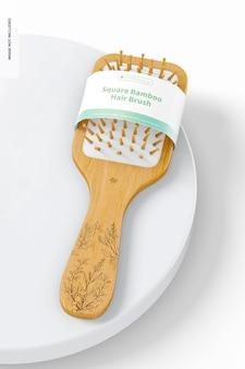 Makieta kwadratowej bambusowej szczotki do włosów, na powierzchni