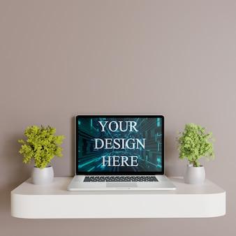 Makieta laptopa na białej ścianie biurko z roślinami, widok z przodu