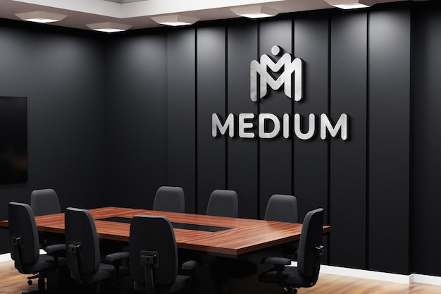 Makieta logo biura na czarnej ścianie w sali konferencyjnej