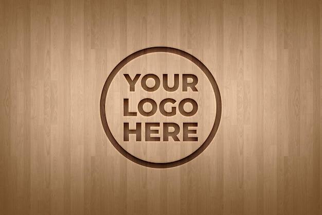 Makieta logo efekt grawerowania na tekstury tła drewnianej podłogi