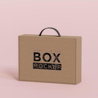 Makieta logo kartonowe beżowe pudełko na różowym tle do brandingu renderowania 3d