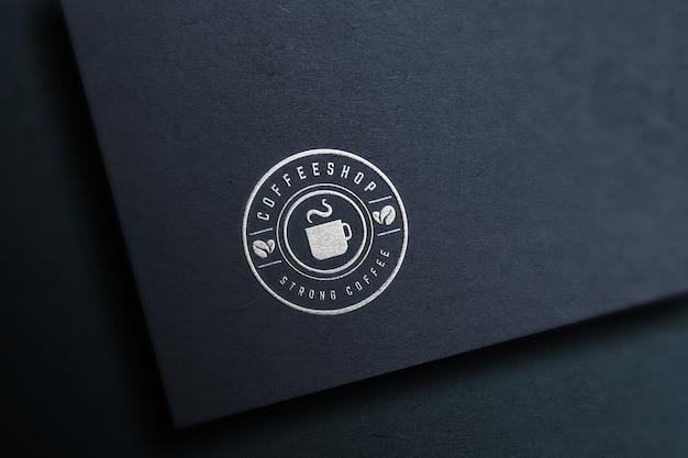 Makieta logo na ciemnym papierze
