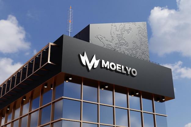 Makieta logo na czarnej fasadzie sklep biurowy znak