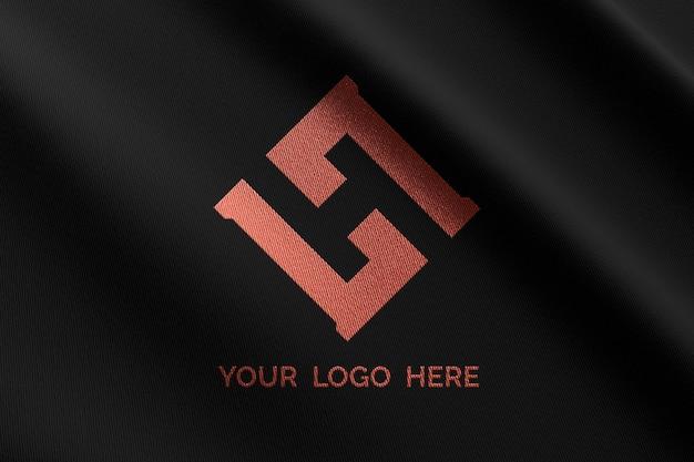 Makieta logo na czarnej tkaninie