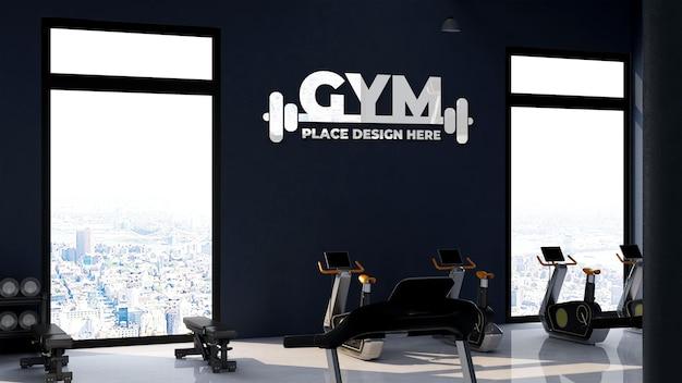 Makieta logo na ścianie w siłowni lub sali sportowej
