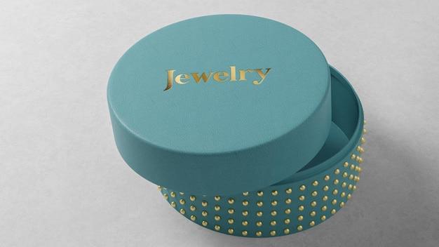 Makieta logo niebieskie okrągłe pudełko z biżuterią na stole