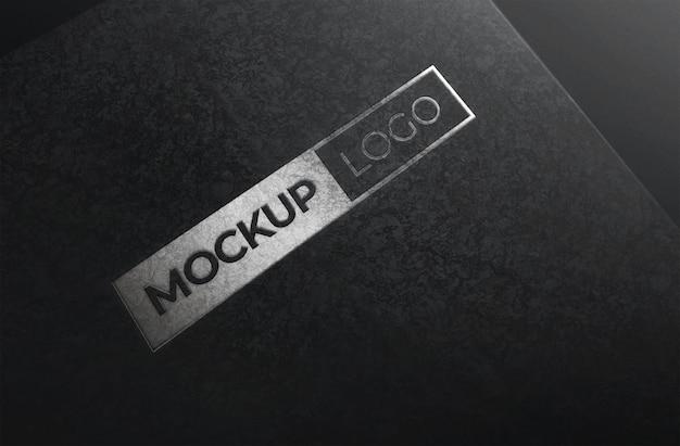 Makieta logo srebrna folia z czarnym tle tekstury papieru
