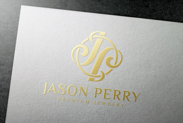 Makieta logo tłoczenia złotą folią na białej karcie papieru