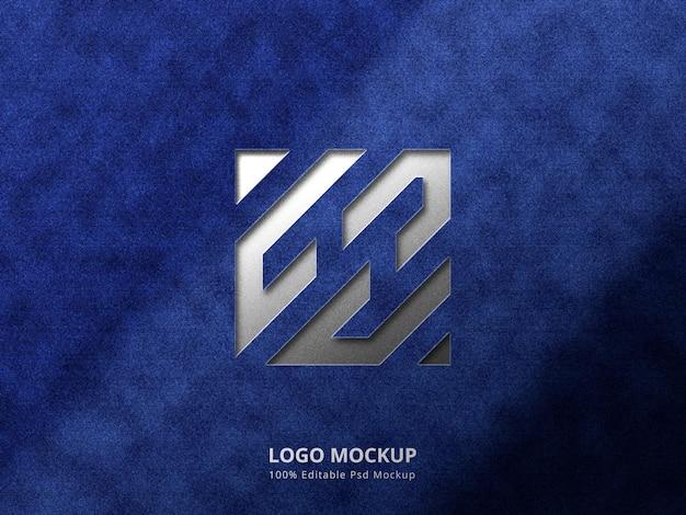 Makieta logo wytłaczania i tłoczenia na tle tkaniny