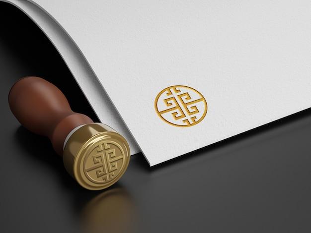 Makieta logo z makietą logo ze złotym efektem prasy stamp