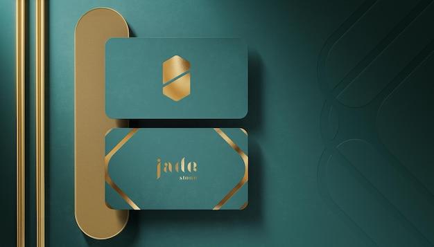Makieta luksusowego logo na wizytówce w kolorze jadeitowym