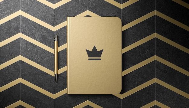 Makieta luksusowego logo na złotym pamiętniku w renderowaniu 3d