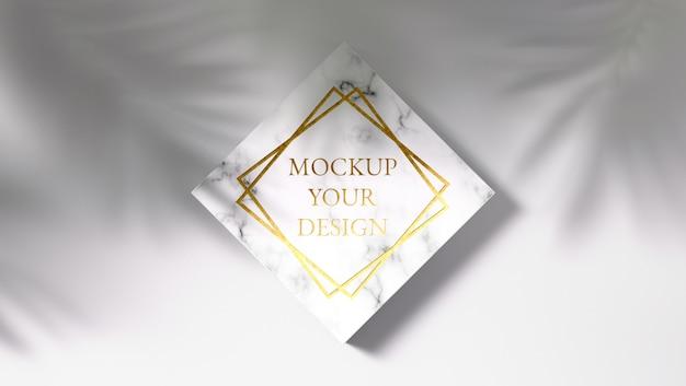 Makieta luksusowego złotego logo na marmurze