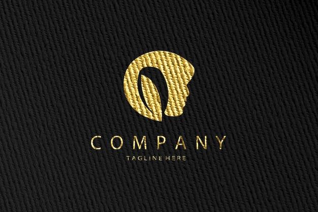 Makieta luksusowej urody złotej tkaniny z logo