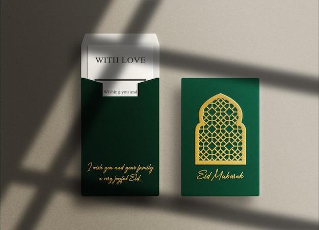 Makieta luksusowej zielonej koperty pionowej z tłoczonym złotem