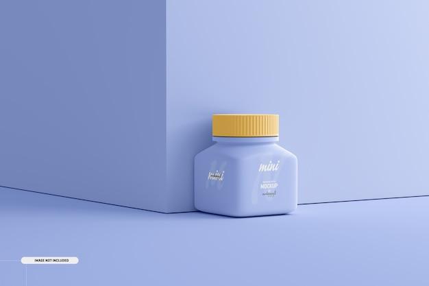 Makieta małej kwadratowej butelki z suplementem pigułki