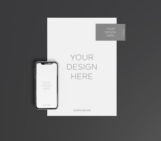 Makieta marki ze smartfonem, wizytówki i papieru a4 widok z góry