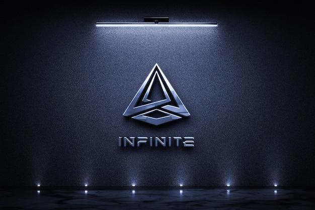 Makieta metalowego znaku logo na ciemnej betonowej ścianie