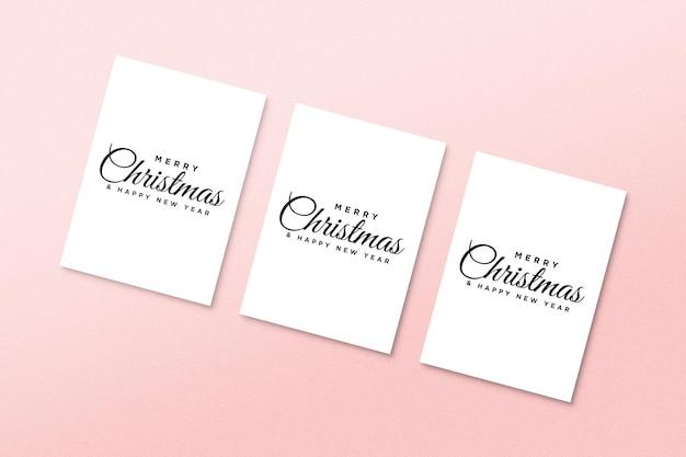 Makieta papierowej kartki z życzeniami z elementami świątecznymi