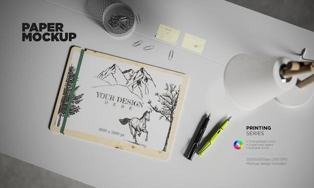 Makieta papieru a4 z wiecznymi piórami na biurku
