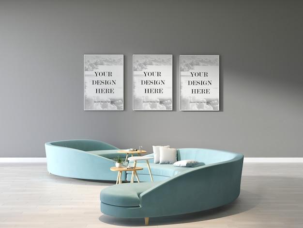 Makieta potrójnych ramek do zdjęć na szarej ścianie z nowoczesną zieloną okrągłą sofą w poczekalni