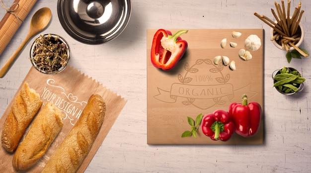 Makieta powierzchni kuchennej chrupiący chleb i warzywa