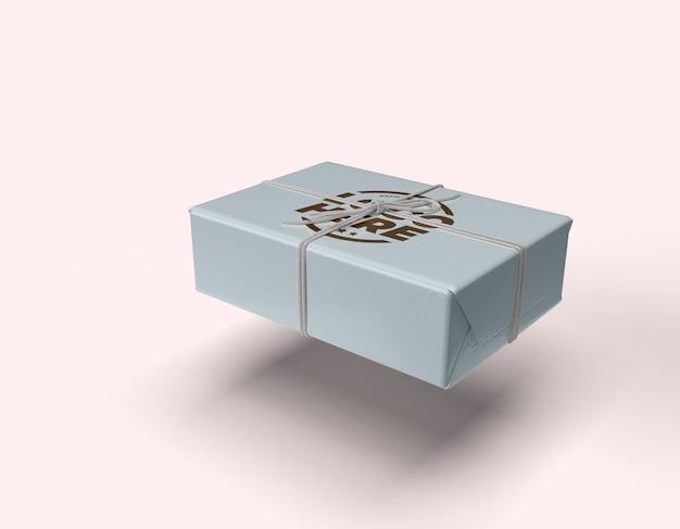 Makieta pudełka na sznurki w grafity projekt na białym tle