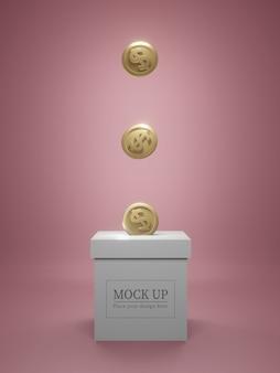 Makieta pudełka ze złotymi monetami.