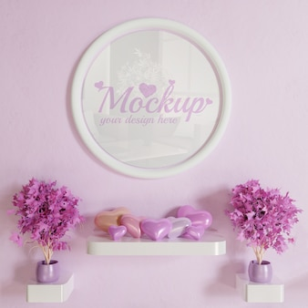 Makieta ramki białe koło na różowej ścianie z wiszącą dekoracją w kształcie serca