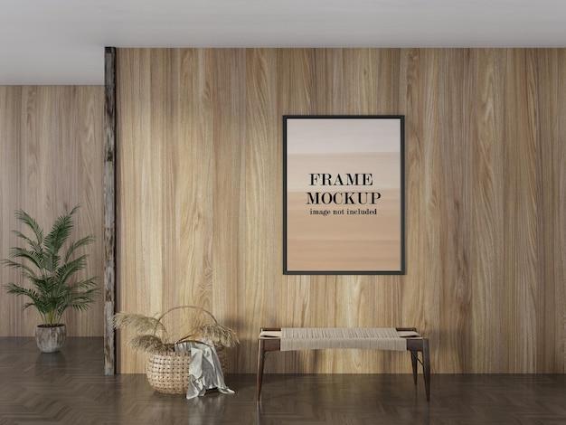 Makieta ramki na zdjęcia na drewnianej ścianie