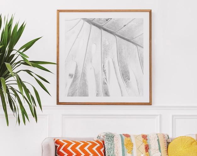 Makieta ramki na zdjęcia z artystycznym wystrojem domu
