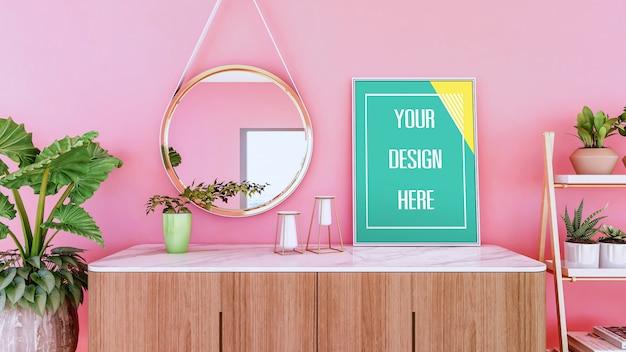 Makieta ramki na zdjęcie na kredensie i różowej ścianie