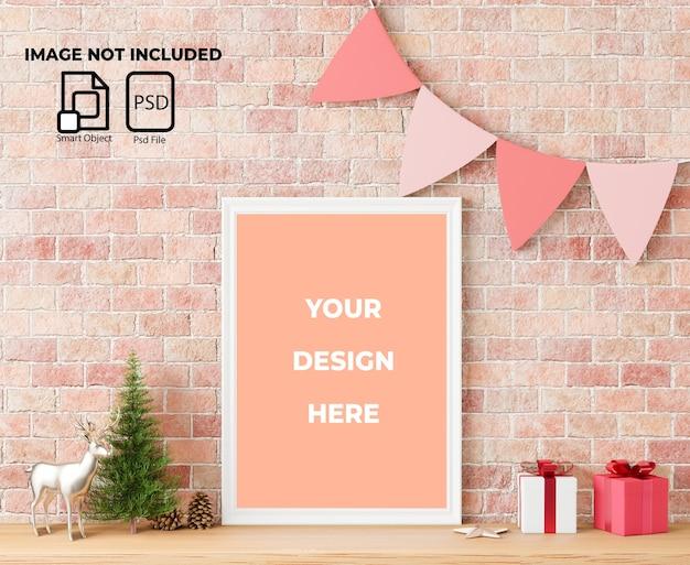 Makieta ramki z dekoracjami świątecznymi i prezentami