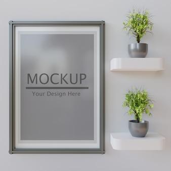 Makieta ramy poziomej z kilkoma roślinami na półce ściennej.