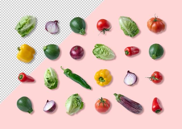 Makieta różnych warzyw wyizolowana z różowego tła
