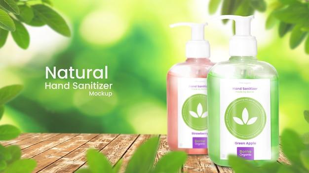 Makieta sanitizer ręcznie dwie butelki pompy żel alkohol na organicznych liściastych tle