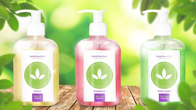 Makieta sanitizer ręcznie trzy butelki pompy żel alkohol na organicznych liściastych tle