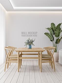 Makieta ściany wewnętrznej jadalni na białej ścianie z drewnianym stołem i roślin
