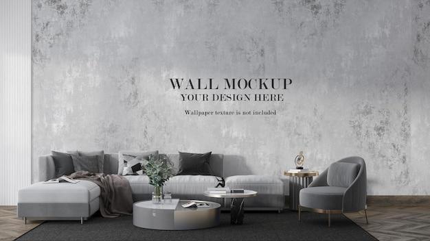 Makieta ściany za dużą szarą sofą