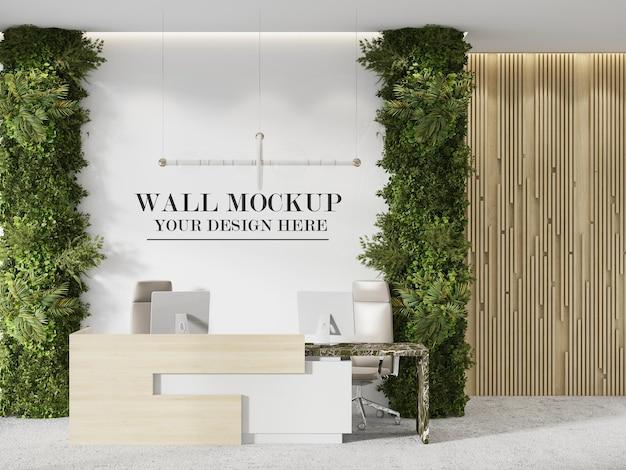 Makieta ścienna dla twojej marki lub logo między roślinami