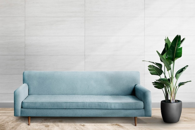Makieta ścienna psd z niebieską sofą w salonie