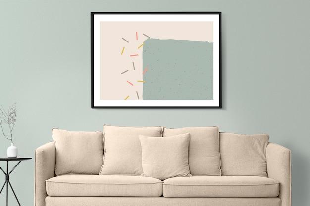 Makieta ścienna z ramką na zdjęcia psd z nowoczesnym fotelem w minimalistycznym wystroju salonu