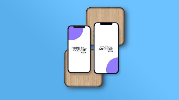 Makieta smartfona różnej wielkości na białym tle na kawałek drewna