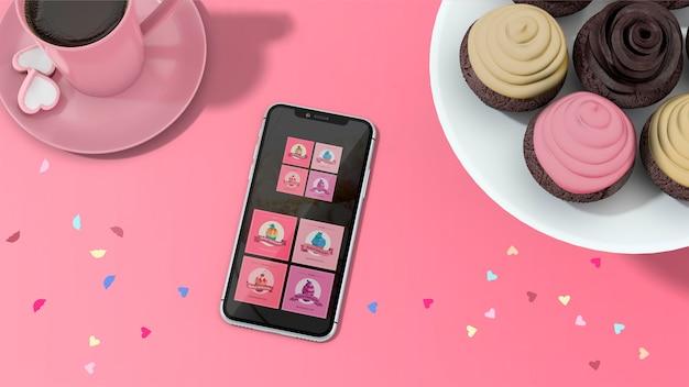 Makieta smartfona z babeczkami