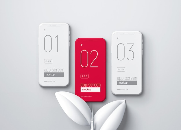 Makieta smartfona z białymi liśćmi