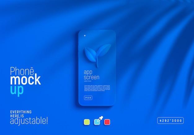Makieta smartfona z cieniem liści