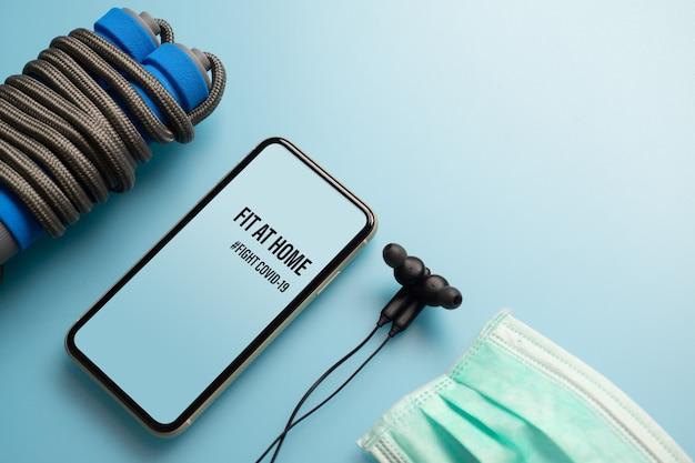 Makieta telefonu komórkowego dla zdrowego w domu, bądź aktywny podczas pandemii wirusów. walcz z covid-19