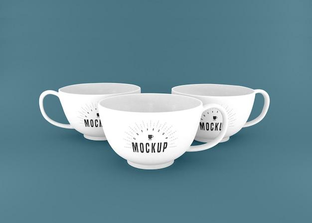 Makieta trzech białych filiżanek kawy psd