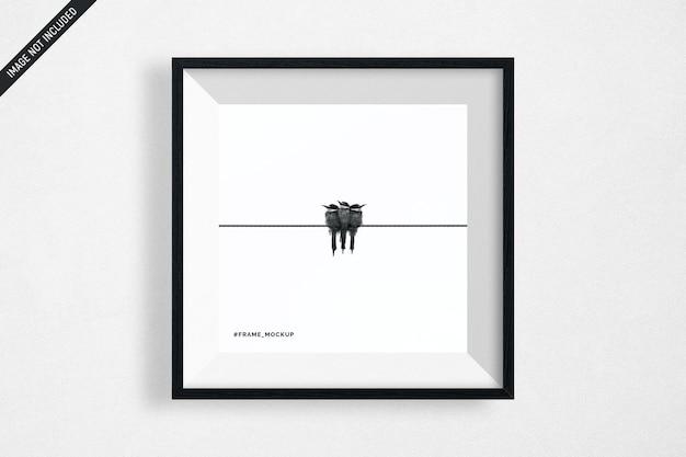 Makieta wiszące czarne kwadratowe ramki na białym tle